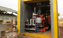 The containerized 275 kW gas engine and hot water distribution system